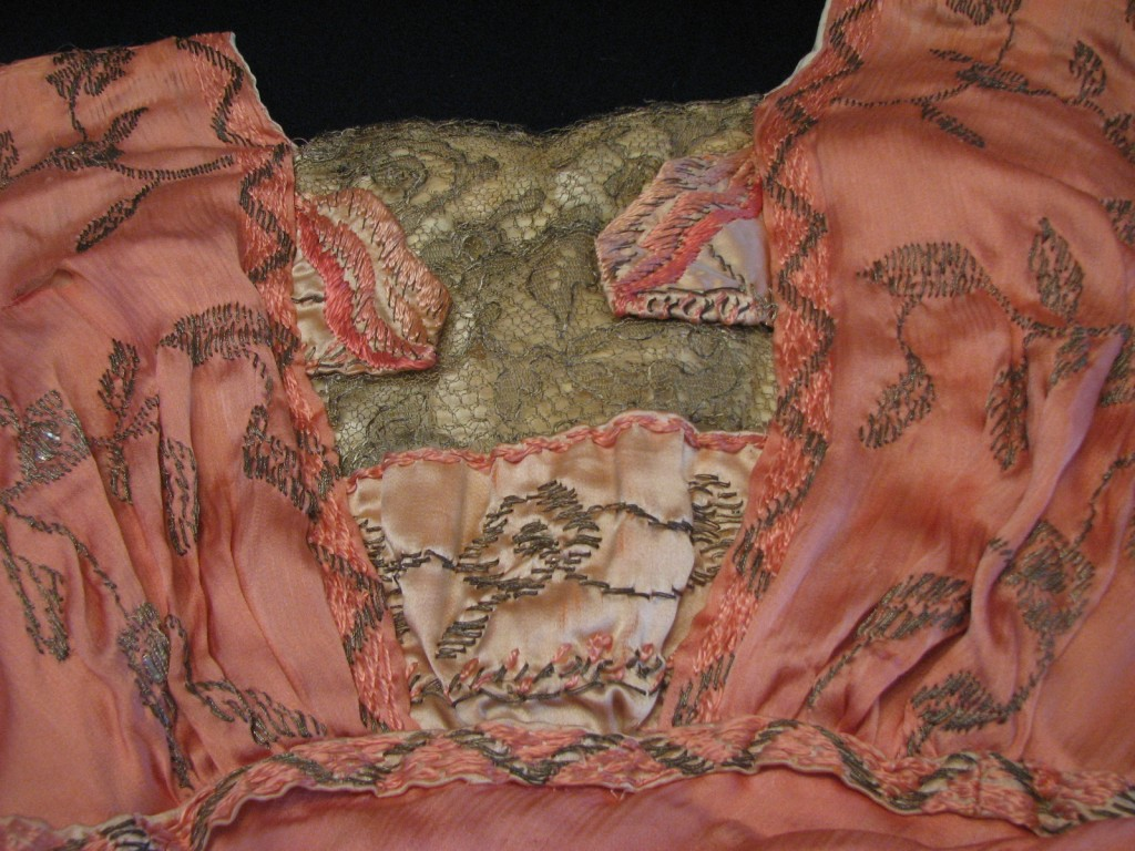 The outside layers of the bodice were constructed over the boned foundation, giving the appearance of a soft kimono sleeve over the lace insert.