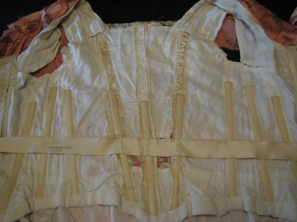 The inside of the bodice showed 19th century contstruction and boning.